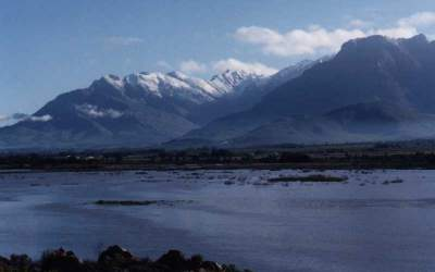 snowy peaks behind Berg river in flood