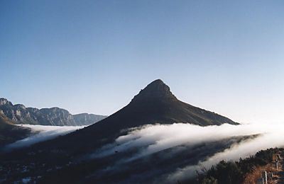 fog rolling over Kloof Nek past Lion's Head